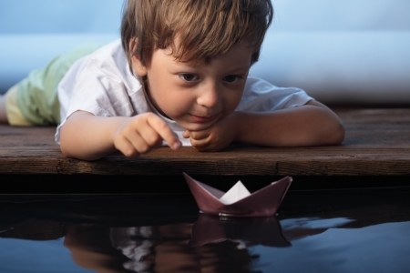 paper ship in children hand Stock Photo