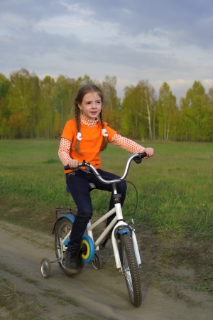 beauty girl o bicycle outdoors photo
