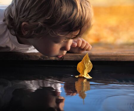 yellow boats: leaf ship in children hand