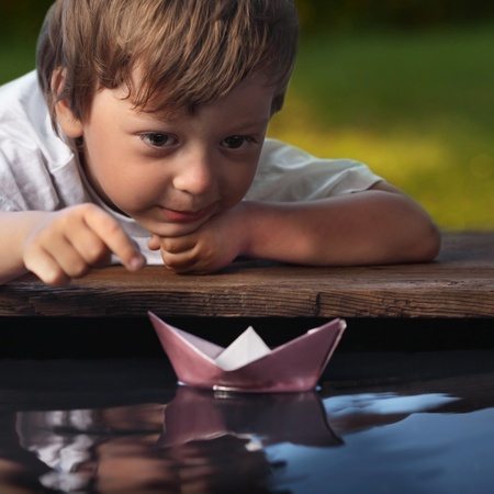 sail boat: paper ship in children hand Stock Photo
