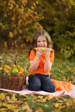 girl with fruit in park photo