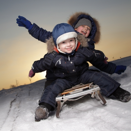 toboggan: two happy boys on sled