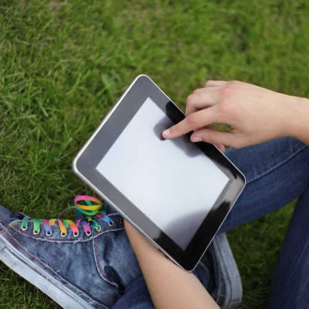 Beauty girl with tablet PC al aire libre photo