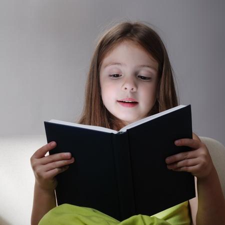 read bible: beauty girl read book on sofa Stock Photo