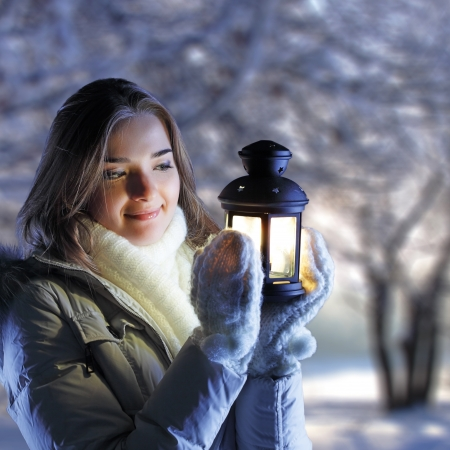 beautiful girl on winter forest with lantern Stock Photo