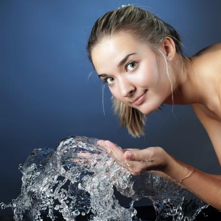 wash face: beauty girl wash face  Stock Photo