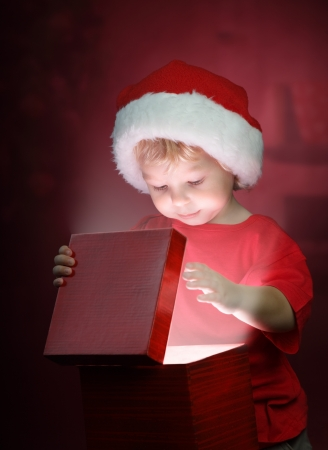 christmas boy on red background Stock Photo