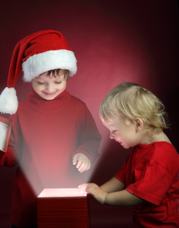 two happy boy open christmas gift-box photo