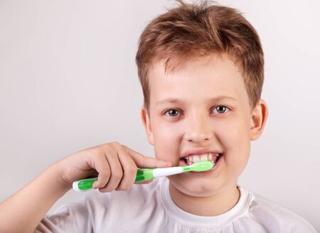 toothbrushing: happy boy with tooth brush