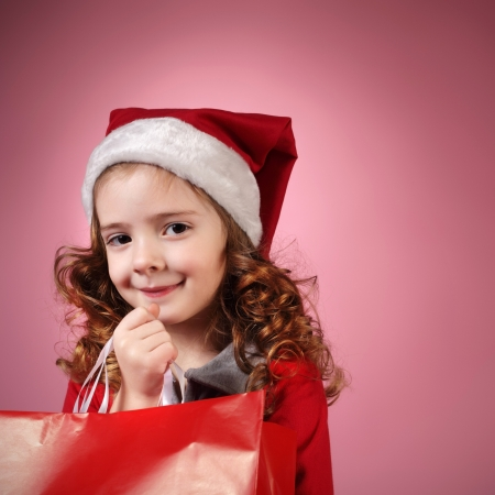 christmas girl on red background photo