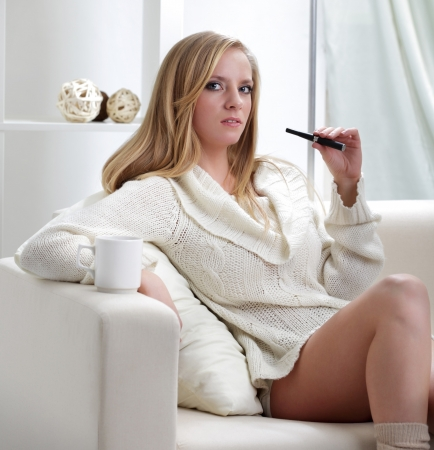 women smoking: beauty girl indoors with e-cigarette