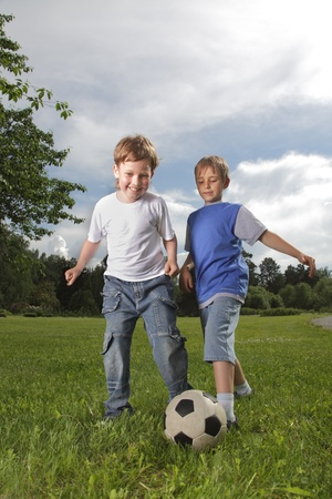 soccerball: two happy boy play in soccer