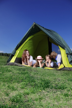 happy family in tent photo