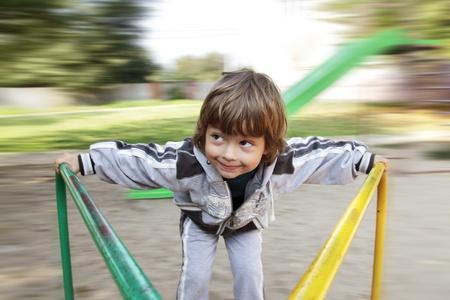 happy boy on carousel outdoors Stock Photo