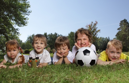 kids  soccer: Happy boys with soccer ball  Stock Photo