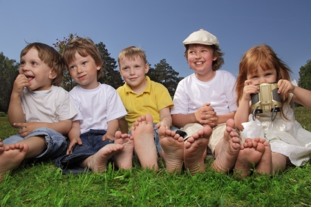 boys only: happy children on grass outdoors