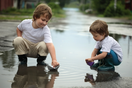 family activities: two boy play in water