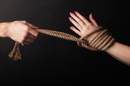 woman rope: bound hands Stock Photo