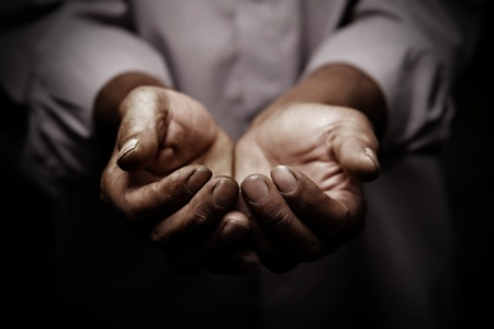 poverty relief: working hands of old man