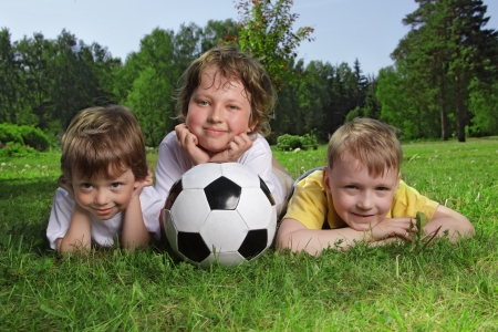 Happy boys with soccer ball  photo