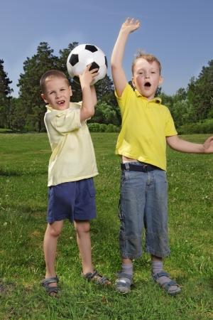 Happy boys with soccer ball  photo