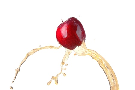 red apple in juice stream Stock Photo - 17969387