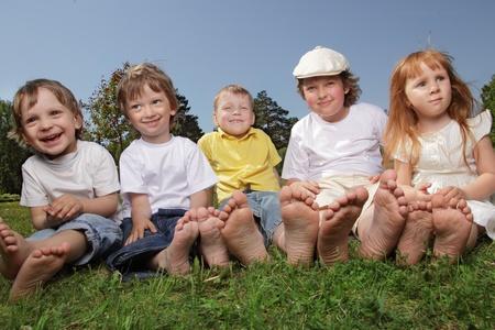 happy children on grass outdoors photo