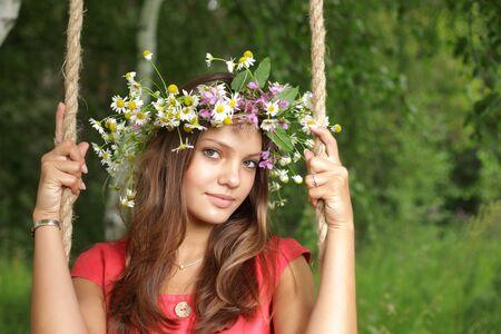 girl on swing: beauty girl on swing outdoors  Stock Photo