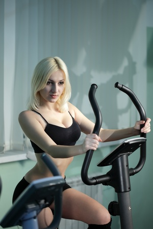 beauty girl on bicycle exercise photo