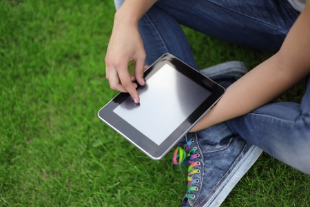 Beauty girl with tablet PC outdoors photo