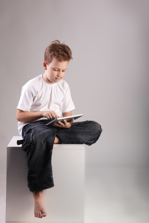 boys only: boy with tablet PC