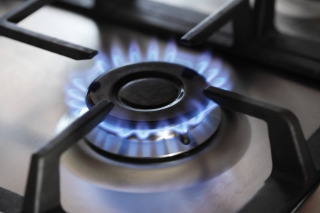 gas stove, focus on center burner