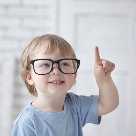 clever baby in glasses photo