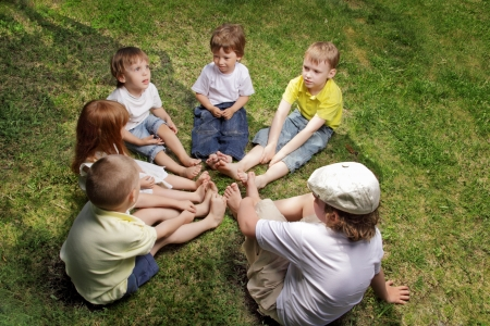 touching toes: children barefoot