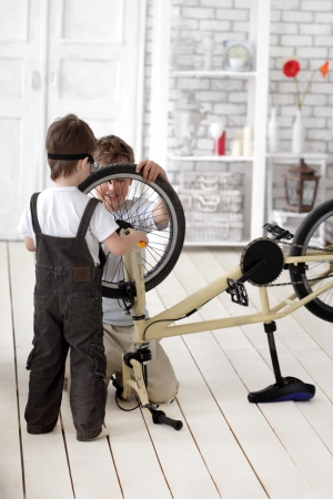 two boy  repairing bicycle photo
