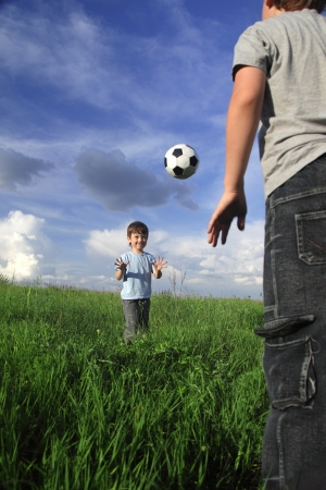 two boy play in ball outdoors photo