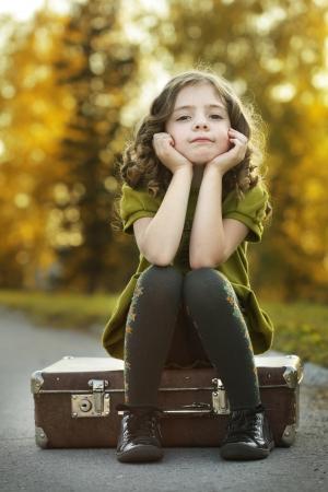 resentful:  resentful girl on suitcase