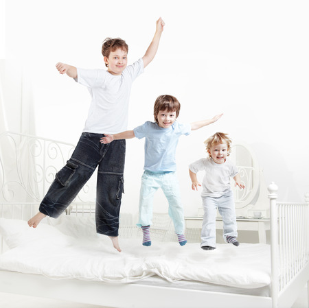 tree boy jump on bed photo