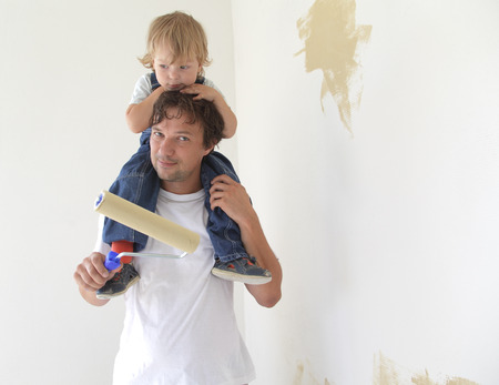 father and son paint room photo