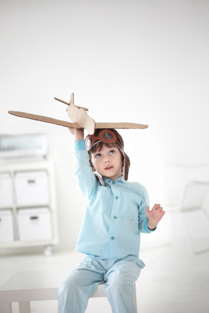 happy boy play in airplane  indoors photo