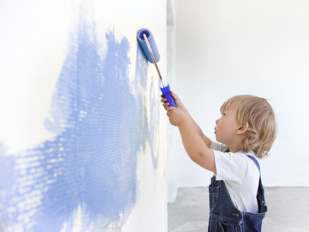 painted wall:  children paint indoors Stock Photo