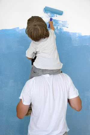children painting: father and son paint room