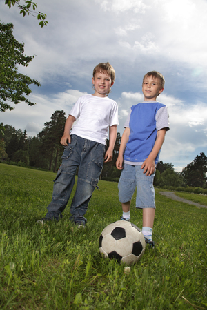 two happy boy play in football photo