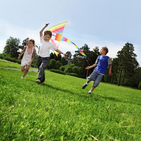 two happy boy with kite Standard-Bild