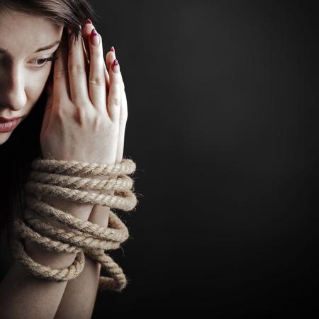 bonding rope: bound hands Stock Photo
