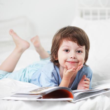 child reading: happy boy read book Stock Photo
