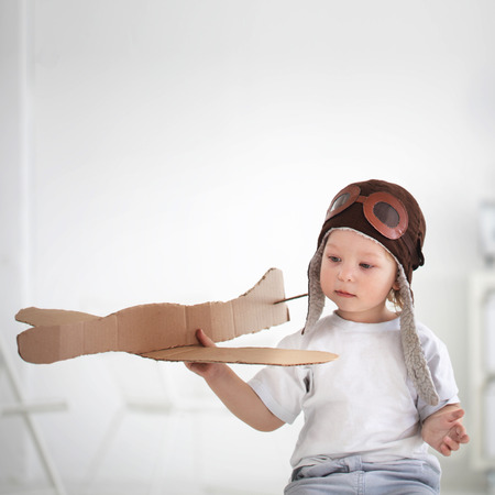 model airplane: happy boy play in airplane  indoors