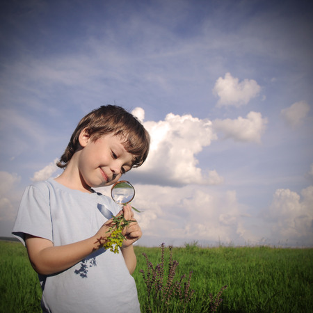child with magnifying glass photo
