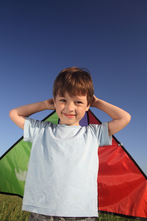handcarves: happy boy with kite Stock Photo