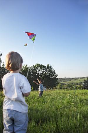 two happy boy with kite photo
